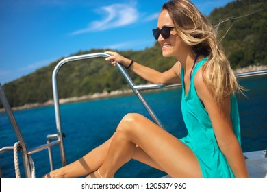 Young beautiful woman sitting on the yacht