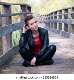 Young beautiful woman sitting in the Park
