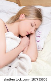 young beautiful woman sleeps in bedroom at home