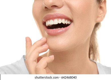 Young beautiful woman smiling on white background. Oral hygiene concept