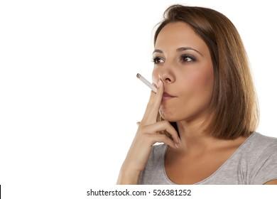young beautiful woman smokes a cigarette