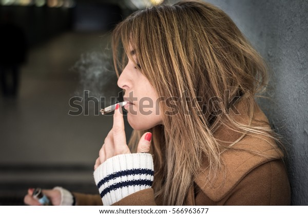 young beautiful woman smoking cigarette