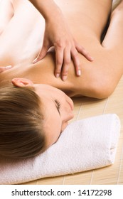 young beautiful woman in a spa is getting a massage