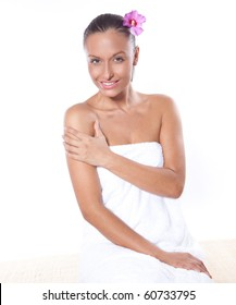 young beautiful woman in a spa with towels
