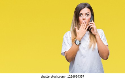 Young beautiful woman speaking calling using smartphone over isolated background cover mouth with hand shocked with shame for mistake, expression of fear, scared in silence, secret concept