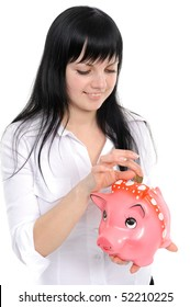 Young beautiful woman standing with piggy-bank (money box), isolated on white background