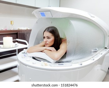 young beautiful woman at steam SPA capsule - beauty treatment woman at steam SPA capsule - beauty treatment