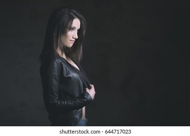 Young beautiful woman in studio on black background.