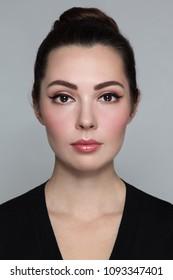 Young beautiful woman with stylish cat eye make-up