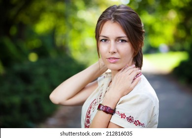 Young beautiful woman in summer park
