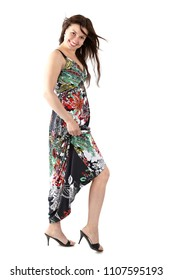 young beautiful woman in sundress with colorful flower pattern, playfully exposing the leg
