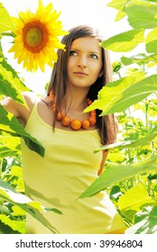 Young beautiful woman in sunflowers