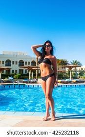 Young beautiful woman in swimsuit in swimming pool