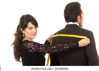young beautiful woman tailor designer taking measures of male client's back isolated on white