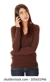 Young beautiful woman is talking by phone. She's looking up and listening. Isolated on the white background.