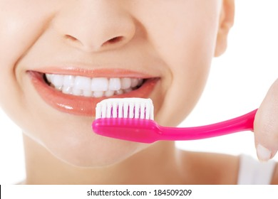 Young beautiful woman with toothbrush and paste. Isolated on white.