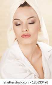 young beautiful woman with a towel on her head posing