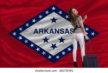 young beautiful woman is traveling to arkansas