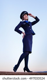 The young beautiful woman in the uniform of the flight attendant in working clothes