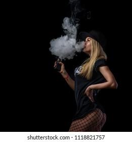 Young beautiful woman is vaping an e-cigarette