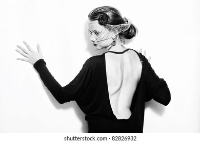 Young beautiful woman in the veil on a white background