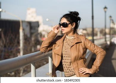Young beautiful woman visiting a city center during a sunny