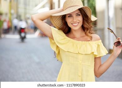 Young beautiful woman walking the streets of an Italian town