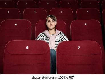 Young beautiful woman watching a movie