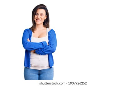 Young beautiful woman wearing casual clothes happy face smiling with crossed arms looking at the camera. positive person.