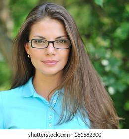 Young beautiful woman wearing glasses - closeup