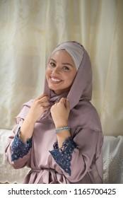 young beautiful woman wearing hijab smiling