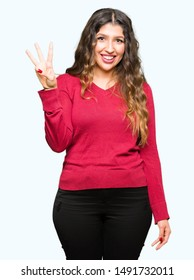 Young beautiful woman wearing red sweater showing and pointing up with fingers number three while smiling confident and happy.