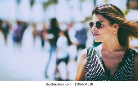 Young beautiful woman wearing sunglasses outdoor. Vintage nostalgia photo