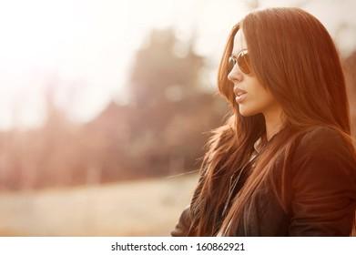 Young beautiful woman wearing sunglasses  - closeup