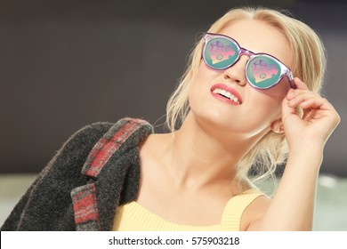 Young beautiful woman wearing sunglasses with hearts