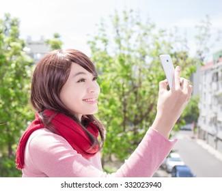 Young beautiful woman wearing winter clothing and photo selfie, asian beauty