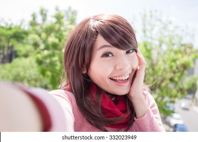 Young beautiful woman wearing winter clothing and photo selfie, asian beauty