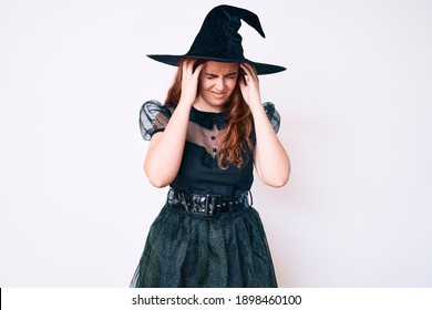 Young beautiful woman wearing witch halloween costume suffering from headache desperate and stressed because pain and migraine. hands on head.
