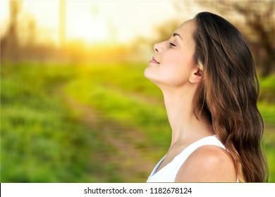 Young beautiful woman in white shirt outdoors
