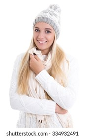 young beautiful woman in winter clothes isolated on white background