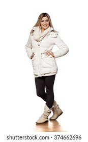 young beautiful woman in winter clothes posing in studio
