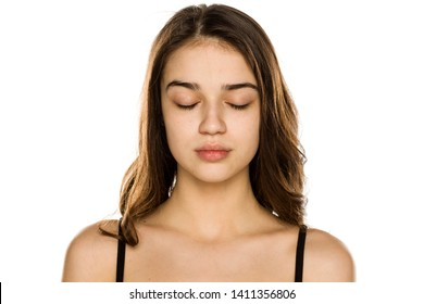 Young beautiful woman without makeup on white background