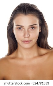 young beautiful woman without makeup on a white background