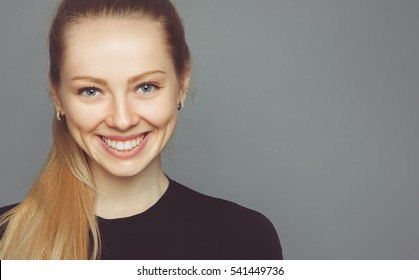 Young beautiful woman without make-up with kindly smile
