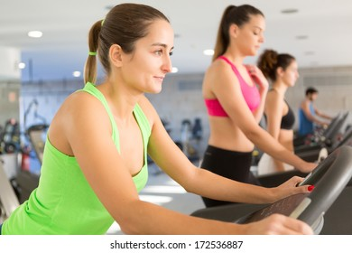 A young and beautiful woman working out at the gym