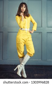 young beautiful woman in yellow work suit