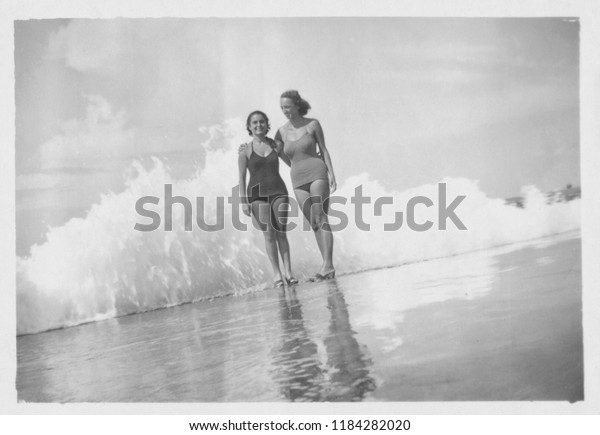 Young beautiful women by the sea, 1950
