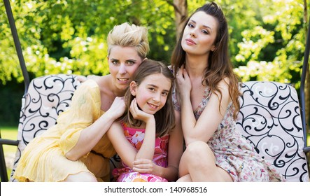 Young beautiful women in the garden