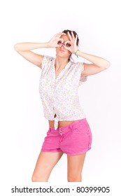 young beautiful women making glasses gestures on face on white background