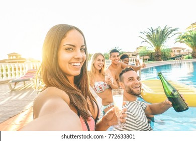 young beautiful women taking a selfie with her friends making pool party drinking champagne - Happy group having fun celebrating with alcohol - Youth,vacation. lifestyle, addiction concept